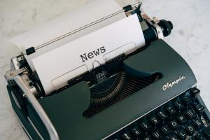 Typewriter with the word 'news' printed on the inserted paper.